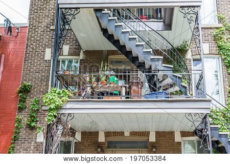 Montreal, Canada - May 27, 2017: People Sitting On Balcony By Apartment In Plateau Neighborhood Duri