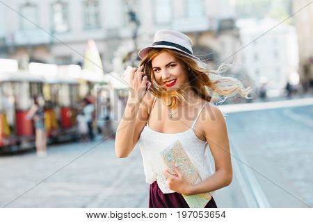 Girl In Hat With Map And Phone
