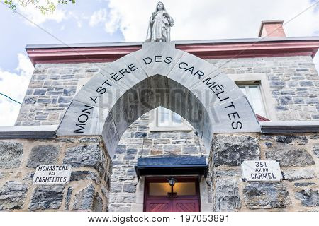 Montreal, Canada - May 27, 2017: Monastery Des Carmelites Church Entrance With Arch On Street In Pla