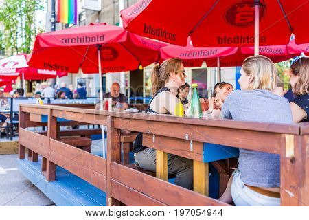 Montreal, Canada - May 27, 2017: People Sitting In Restaurant At Table In Outside Seating Area In Pl