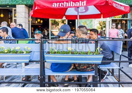 Montreal, Canada - May 27, 2017: Homosexual Couple Sitting In Restaurant At Table In Outside Seating