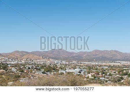A view of Kleine Kuppe Prosperita Cimbebasia and Olympia all suburbs of Windhoek the capital city of Namibia. Grossherzog mountain is in the back