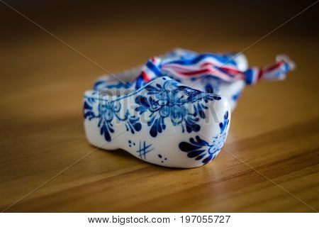 BERLIN - JUNE 03 2015: Traditional souvenirs from Holland. Ceramic shoes (Klompen). Focus on the foreground. Shallow DOF.