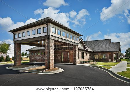 Brown Brick Recreational Executive Office Dentist Doctor's Office Building Exterior with Portico Entrance