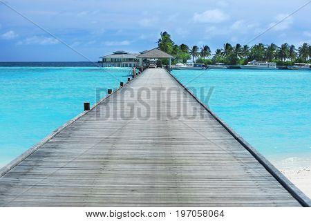 Wooden pontoon on sea beach in summer day