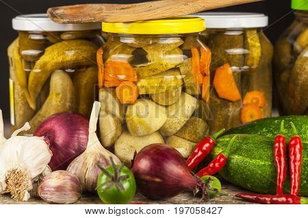 Preparing sour cucumbers in the kitchen. Pickled cucumbers in jar. Home canning vegetables. Life on the farm