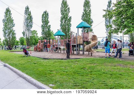 Montreal, Canada - May 27, 2017: Old Port Area Playground With People And Children Playing In City I