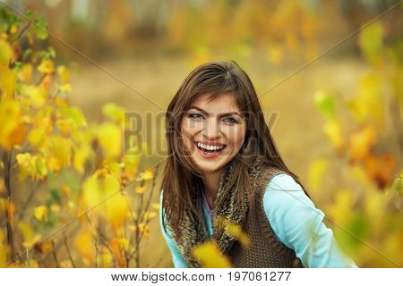 outdoor portrait of a beautiful brunette middle aged woman