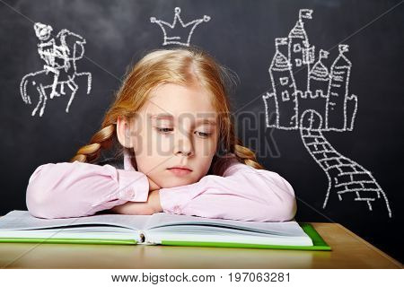 girl reading a book. School and education. imagination concept. cartoon fairy tale castle and the crown princess doodle