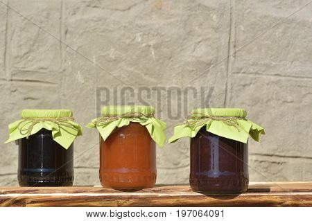Glass jars with homemade jam. Fresh homemade  jam in glass jar