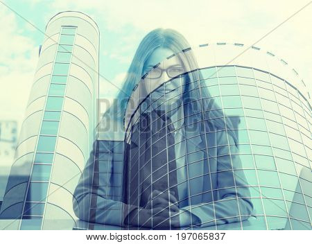 Concept of consulting. Double exposure of cityscape and young businesswoman