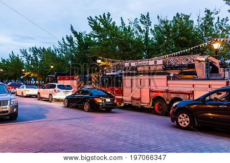 Montreal, Canada - May 27, 2017: Old Town Area With Fire Truck On Street In Evening Outside Restaura