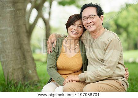 Portrait of hugging happy Vietnamese elderly couple in love