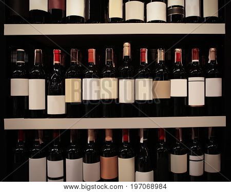 Rack with bottles of wine at store