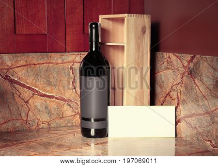 Bottle of wine with wooden box on table at store