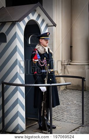 PRAGUE CZECH REPUBLIC - APRIL 14 2013: The guard in traditional uniform outside of the Saint Vitus Cathedral.