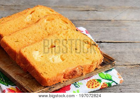 Pumpkin cheese bread slices. Pumpkin bread with cheese filling on a wooden board. Healthy and tasty bread recipe. Closeup
