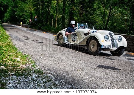 GOLA DEL FURLO, ITALY - MAY 19: BMW 328 1937 on an old racing car in rally Mille Miglia 2017 the famous italian historical race (1927-1957) on May 19 2017