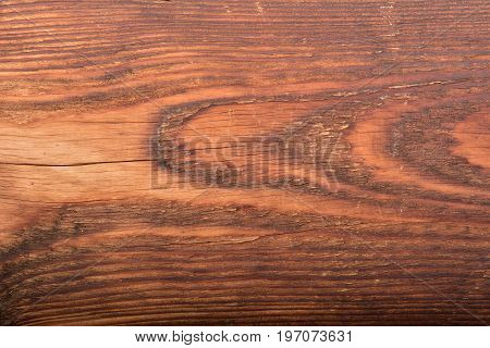 Abstract wood table texture background. Close up dark rustic wood made of old wood table texture. Rustic wood table texture. Old wood texture. Wood table surface top view. Natural wood texture. Surface of wood texture. Vintage wood texture.