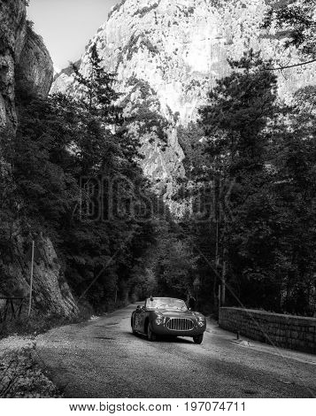 GOLA DEL FURLO, ITALY - MAY 19: CISITALIA 202 SC CABRIOLET 1952 on an old racing car in rally Mille Miglia 2017 the famous italian historical race (1927-1957) on May 19 2017