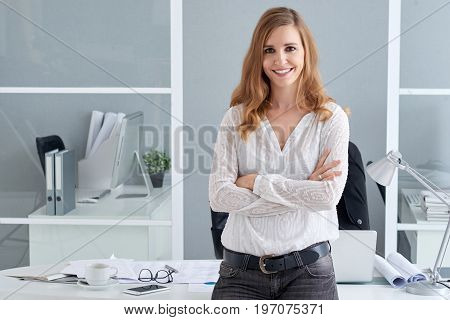 Portrait of confident young business lady smiling and looking at camera