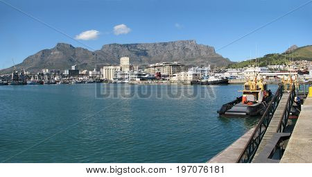 FROM CAPE TOWN, SOUTH AFRICA, THE VICTORIA AND ALFRED WATERFRONT ON A CLEAR SUMMERS DAY