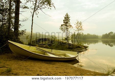 A rowing boat by a lake in Finland