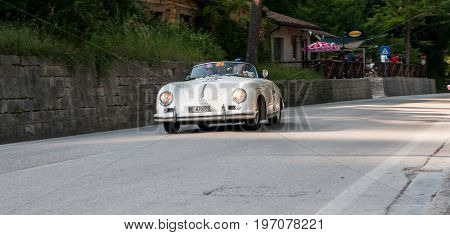 GOLA DEL FURLO, ITALY - MAY 19: PORSCHE 356 1500 SPEEDSTER 1955 on an old racing car in rally Mille Miglia 2017 the famous italian historical race (1927-1957) on May 19 2017