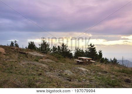 Sunrise In The Mountains And Wooden Table