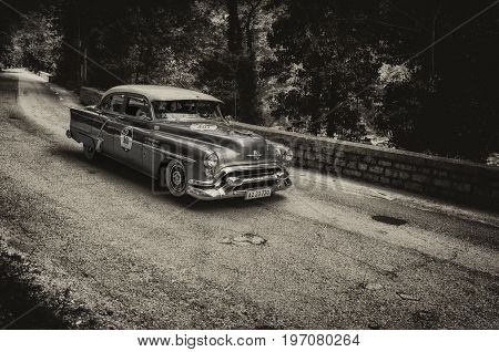 GOLA DEL FURLO, ITALY - MAY 19: OLDSMOBILE 88 1953 on an old racing car in rally Mille Miglia 2017 the famous italian historical race (1927-1957) on May 19 2017