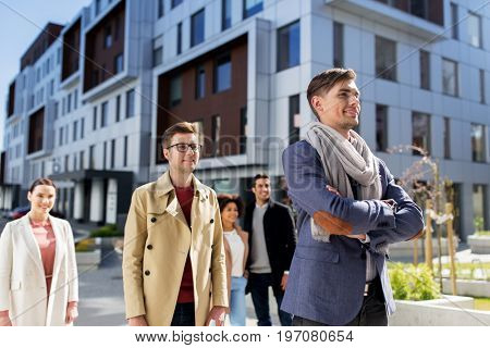 business, education and corporate concept - international group of people on city street