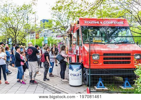 Montreal, Canada - May 27, 2017: Poutine Food Truck With People Waiting In Line Queue In Old Port Bo