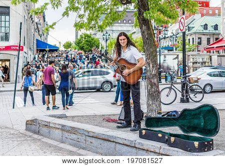 Montreal, Canada - May 27, 2017: Old Town Area With Young Happy Man Smiling Playing Guitar In City I