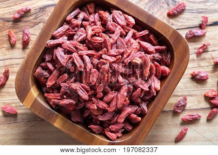 Dried Goji Berries In A Wooden Bowl