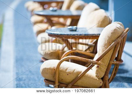 Soft armchairs and tables in a street cafe