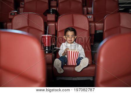 Kid Watching Movie In An Empty Cinema