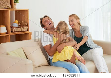 Happy young family having fun at home