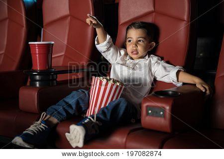 Little Kid Enjoying A Movie At The Cinema
