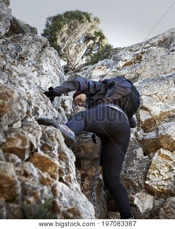 VALDERROBRES, SPAIN. FEBRUARY 9 2017: Mountaineer climbing the last stretch to arrive on the top of Peak in Valderrobres on 9 February, 2017