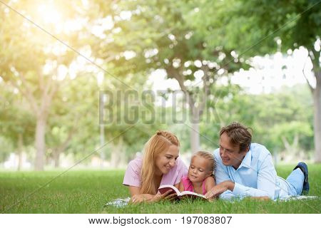 Happy family spending weekend in the park