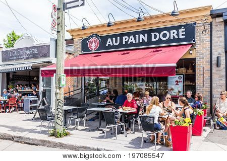 Montreal, Canada - May 28, 2017: Au Pain Dore Restaurant Outside Seating Area With People Sitting At