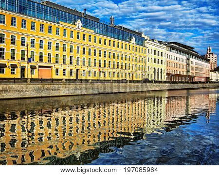 Panoramic view of houses reflection in river water in historic centre of the Moscow city Russia