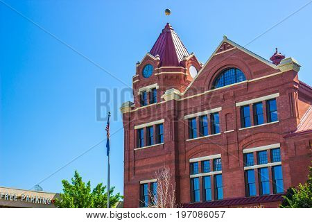 Vintage  Multi Story Brick Building With Clock Tower