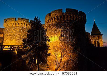 Kalemegdan fortress wooden bridge, gates and towers at twilight in Belgrade, Serbia