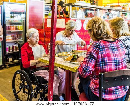 Montreal, Canada - May 28, 2017: Older Women Eating Crepes At Jean Talon Market Creperie Restaurant