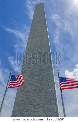 Washington Monument and old glory. A perspective of the US flag in front of the Washington monument in DC.