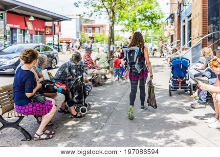 Montreal, Canada - May 28, 2017: People Sitting Outside Restaurants Near Jean-talon Farmers During B
