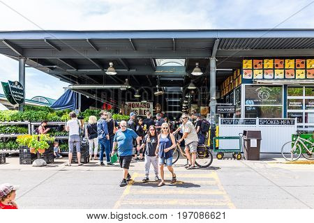 Montreal, Canada - May 28, 2017: Jean Talon Market Entrance With People In Little Italy Neighborhood