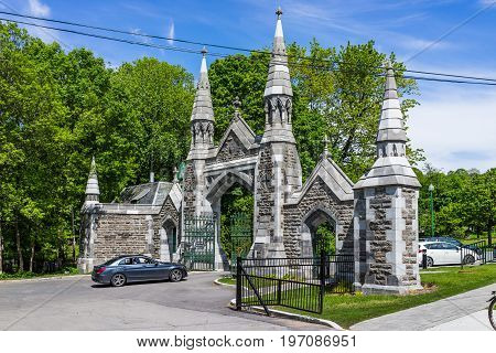 Montreal Canada - May 28 2017: Gate of cemetery on Mont Royal during bright sunny day in Quebec region city