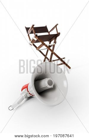 Megaphone and director chair in background -Clipping Path
